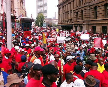 07-03-2012 Army of Red: Cosatu protesters gather for the #CosatuMarch in Johannesburg. Pic by EWN photographer @tshepolesole (Definitely the top SA news story of the day)