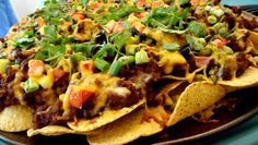 How to make a great Nachos Recipe just like your favorite restaurant nachos --only better. The key to nachos supreme is a spicy nacho topping.