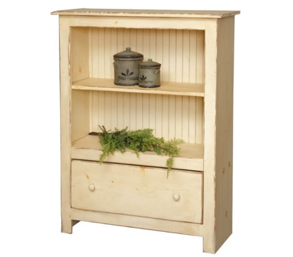 Low Farmhouse Bookcase With Drawer: A great combination of bookshelves and a storage drawer are featured in this farmhouse bookcase. Sized to go just about anywhere this bookcase will provide display and storage for your home. Proudly handcrafted in the USA.