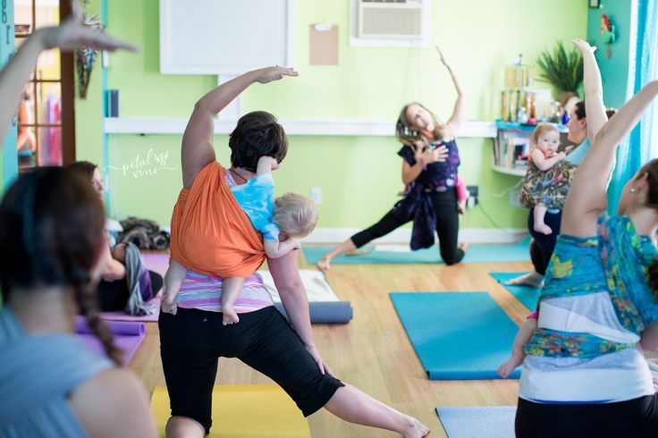 Wrapping Yoga Class for doing yoga with your baby or toddler while wrapped up or babywearing in any safe baby carrier.  Om Sweet Om Yoga Studio Dunedin, Florida. Stunning pictures by Petal & Vine Photography.