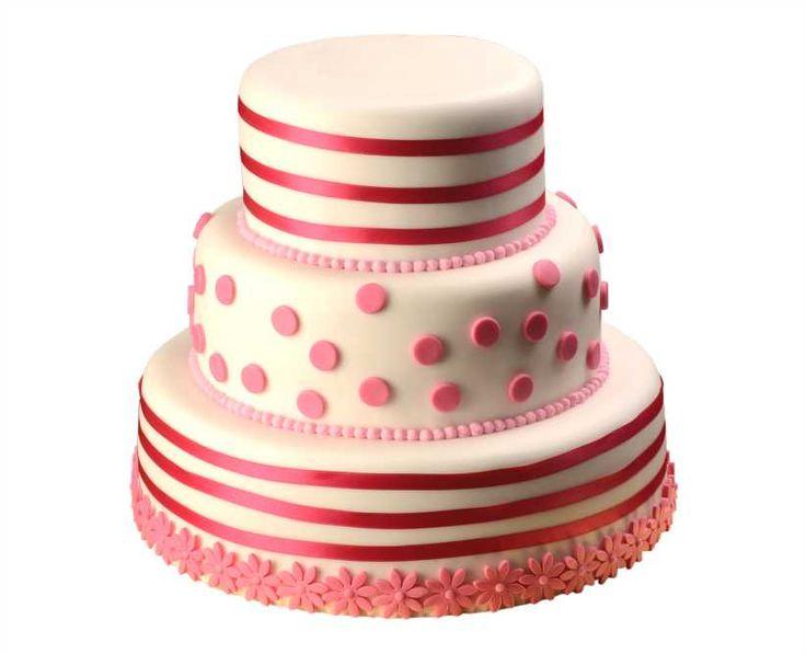Svatební dort 25 Třípatrový svatební dort, o rozměrech 18 cm, 24 cm, 32 cm, obalen fondánem, dozdoben fondánovými vykrajovátky