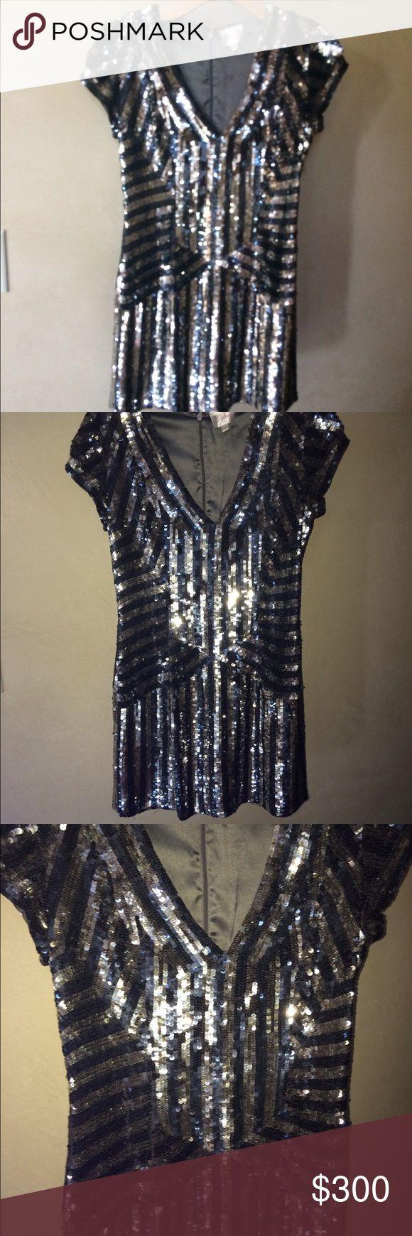 Haute Hippie sequence dress size small Haute Hippie sequence dress size small. Measures 31 inches in length. Lining is 100% silk. Haute Hippie Dresses Mini