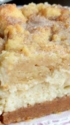 Snickerdoodle Cheesecake Bars ~ Sweet and salty graham cracker pecan crust with a creamy cheesecake layer topped to perfection with snickerdoodle pecan cookie topping