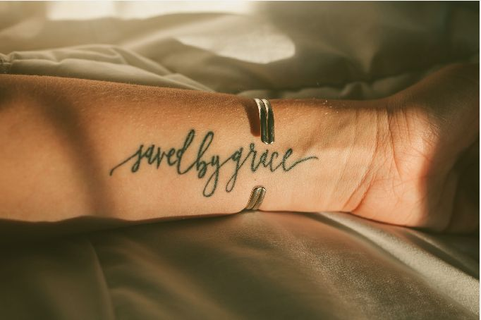 Saved by Grace Custom Calligraphy Tattoo Design - Arm I love this, but I would want it in white ink