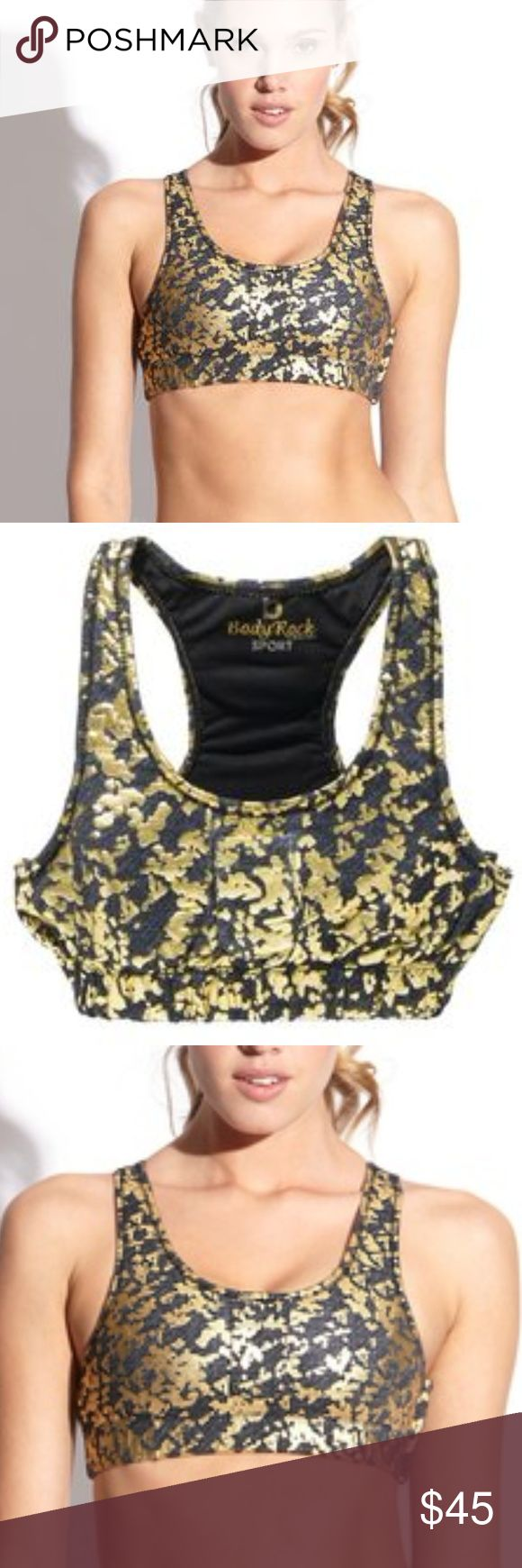 "ODYROCK SPORT MEGAN LOCK EM DOWN SPORTS BRA gold RARE BODYROCK SPORT ""MEGAN"" LOCK EM DOWN SPORTS BRA WITH GOLD STUDS ALONG THE NECKLINE WITH SIDE ZIPPER! Brand new without tags, Navy Blue with Gold Metallic print with gold stud accents along the neckline BodyRock Sport is a manufacturer of sports bras and other clothing in New York City. The bras designed by Kelly Dooley, are described as ""blinged-out"", with Swarovski crystals or studs, Audio pocket, and Zippered pockets. Audio pocket on the…"