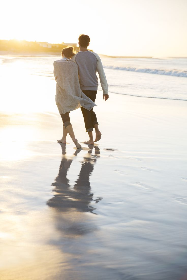 Loving couple walking on the beach at sunset!  My love & I have done this many times and many more times to come!
