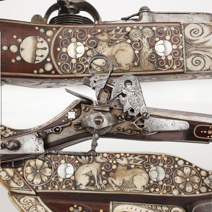 """Engraved Wheellock Rifle- One of our earliest pieces on display in our """"Old Guns in a New World"""" gallery is this wheellock rifle. While nicely engraved, we'll call your attention specifically to the many inlays of animals that appear in bone and ivory over the stock's surface.  Geometric accents segregate the animal aspects of the adornment for this muzzleloading rifle, but the intricate scrimshaw and carving work necessary to complete each of these figures is truly a marvel in miniature."""