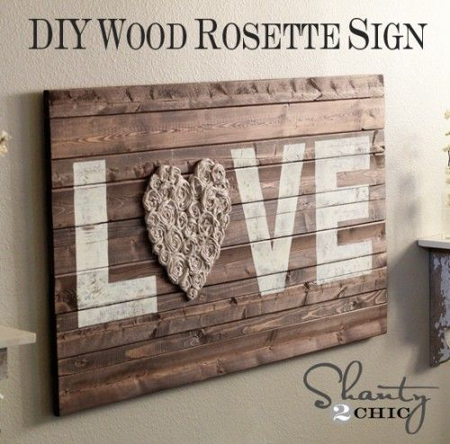 DIY Wood Wall Art with Fabric Rosettes  It would be so cute to make this as a headboard.