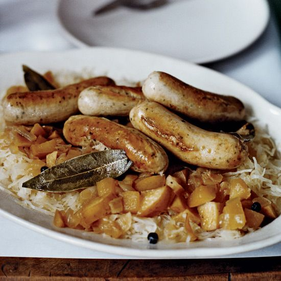 Sautéed German Sausages with Bacon and Apple Sauerkraut   In Germany's Pfalz region, cooks braise sauerkraut with onions, apples, seasonings, a touch of sugar and a little of the region's Riesling wine, creating an addictive accompaniment for juicy weisswurst or bratwurst.