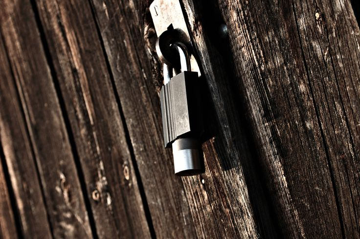 Modern padlock meets classic door by Ferdinand Holzner on 500px