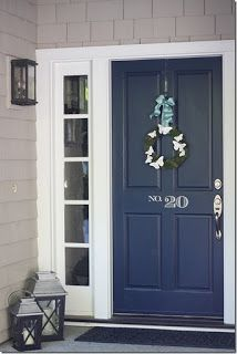 Sherwin Williams Naval front door with white trim side lights