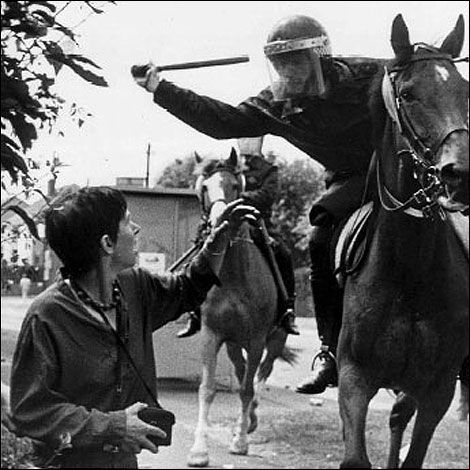 Lesley Boulton, a member of Women Against Pit Closures, about to be assaulted by one of Thatcher's mounted thugs at Orgreave, 1984 © John Harris reportdigital.co.uk