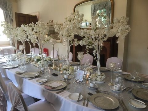 Beautiful blossom tree centerpieces with glass orbs, mixed with crystal globes and lots of tealights to create a stunning wedding table for guests. Venue dressing in the Midlands by Make It Special Events