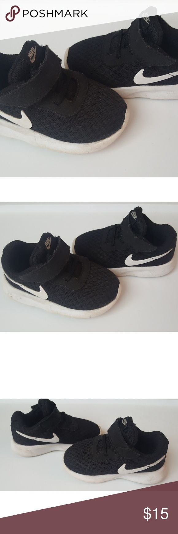 Baby boy Nike shoes -Size is 5c -Color is Black and white -Brand is Nike  -Good used condition (some wear on the bottom as you can see in the pictures)  **All items come from a smoke free and pet free home  **I ship daily  Feel free to send offers and check out my other items for bundle discounts :)  Have a wonderful day!! Nike Shoes Sneakers