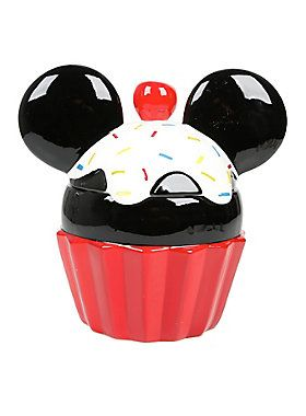 """<p>Cute as a button, with a cherry on top! Mickey Mouse's likeness is the cutest cupcake we could ever imagine, and this cookie jar is making us squeal with joy! Keep all of your favorite, yummy treats safe in this Mickey Mouse cupcake cookie jar from Disney.</p>  <ul> <li>Ceramic</li> <li>10 1/2"""" x 10 1/2"""" x 7 1/2""""</li> <li>Imported</li> </ul>"""