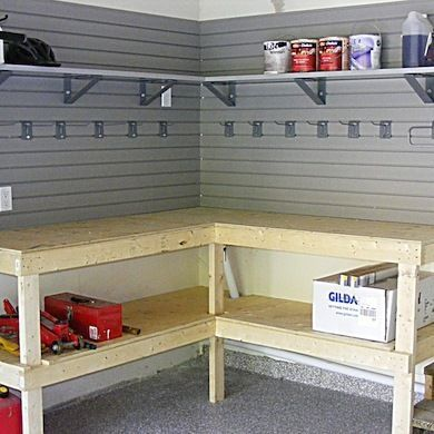 "Utilize the space in your garage or shop efficiently with a corner workbench design. Mounted to the wall, this bench has a lower tier for storage, while additional shelves and hooks keep the necessary tools and materials close at hand. Related: 15 ""Neat"" Garage Storage Solutions"