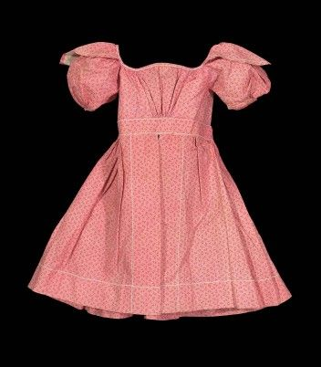 Child's dress Child's dress, about 1825. Printed cotton plain weave, embroidered with cotton; mother of pearl buttons. Gift of Miss Frances ...