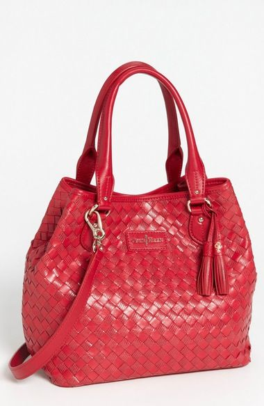 Cole Haan 'Nora Weave - Small Serena' Tote. Mixed-texture strands of leather create the pristine plaiting on a stand-out tote designed with an interior bridge clip to cinch the silhouette into more petite proportions. Magnetic-snap closure with interior bridge-clip strap. Optional, adjustable strap. Interior zip, wall and cell-phone pockets. Logo-jacquard lining. Leather.