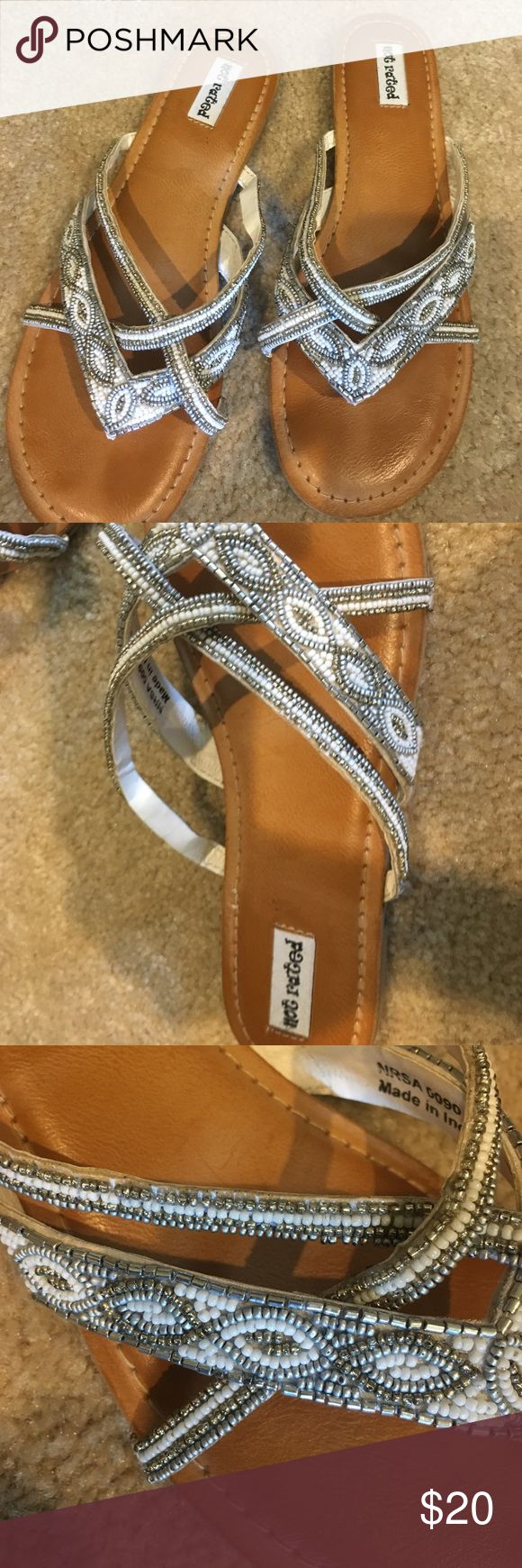 Not Rated size 7.5 Flip flop sandals Beaded Not Rated Fancy Flip Flop Sandals from Buckle.  Cream and Silver, Size 7.5 .  Gently worn no missing beads. Not Rated Shoes Sandals