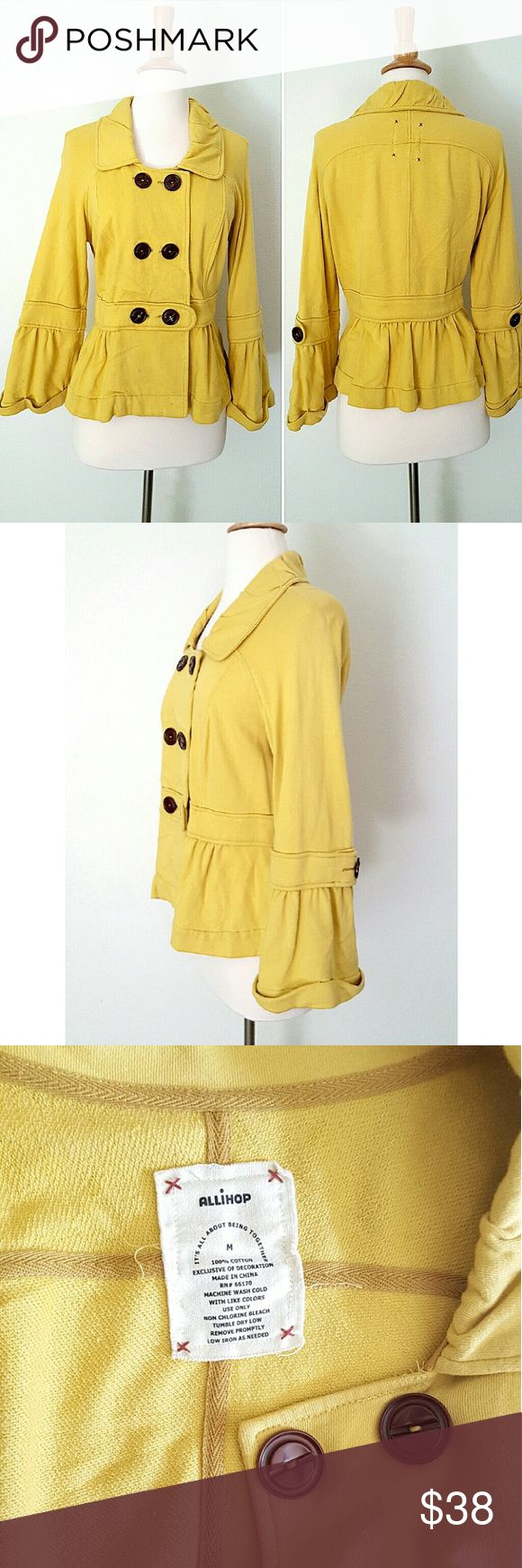 """Anthropologie Bell Sleeve Peplum Jacket Mustard yellow french terry jacket from Allihop. Unlined,  bouble breasted, bell sleeves and peplum bottom. 100% cotton.  15"""" shoulder to shoulder, 18"""" armpit to armpit, 23"""" long  shoulder to bottom hem, sleeves are 21"""" long.  Has a brown stain on the bottom of one sleeve and one tiny one on the peplum  (last pic) most probably from wine. Honestly,  haven't tried to remove it. Other than that in excellent condition. Has one extra button inside…"""