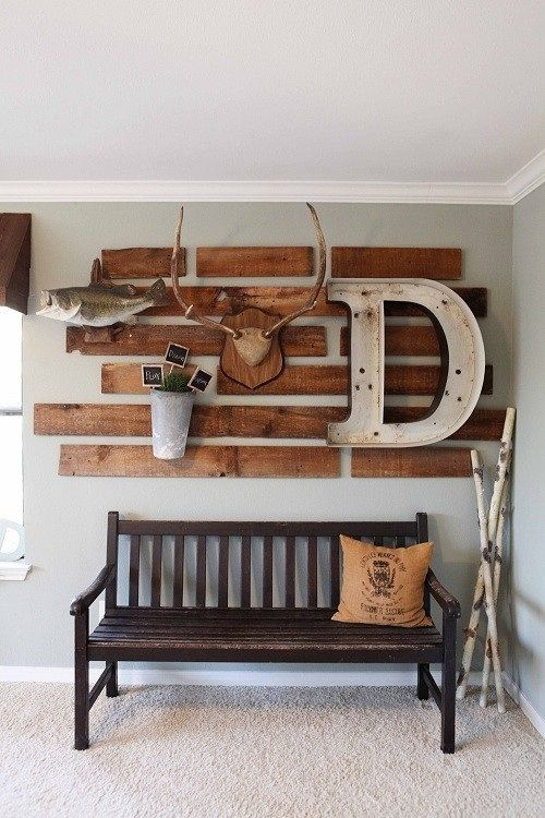 Don't care much for the pallet boards, never got into the whole tearing apart pallets thing. Wood is cheap, and reclaimed wood is everywhere and has much more character. But I love the mounted fish, deer rack, printed burlap throw pillow and old marquee-style letter.