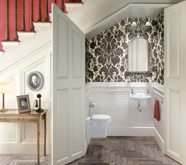 Utilize the space under a staircase with a small bathroom. Always wanted to do this. Love the floors too.
