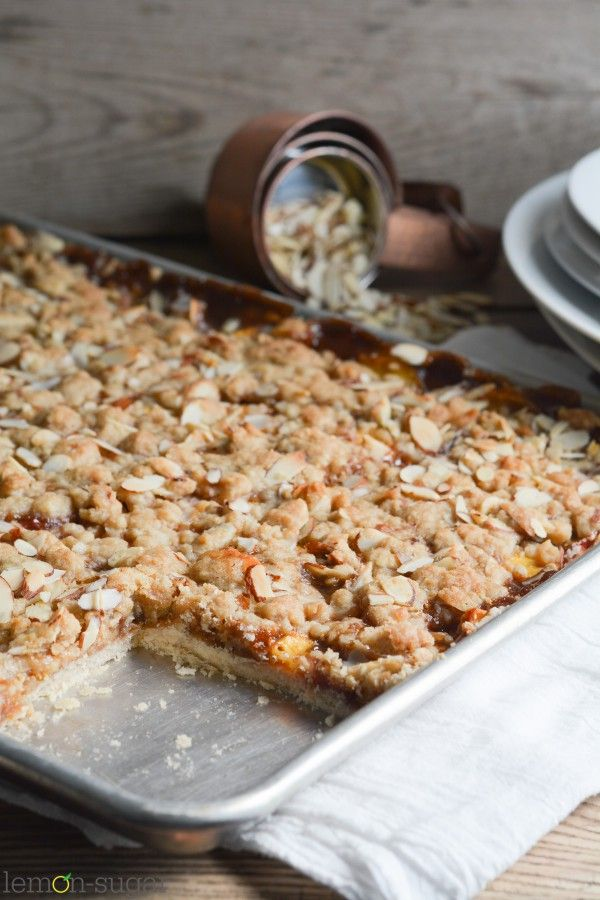 This easy slab pie is bursting with fresh peaches and warm cinnamon flavor, and will make the transition from summer to fall a delicious one! Enjoy!