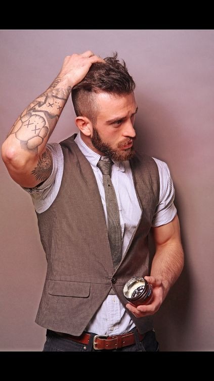 Crazy how just by folding your shirt below your deltoid can make a guy look edgy. Obviously this fella has the tats, hair and facial hair to embrace it even more.