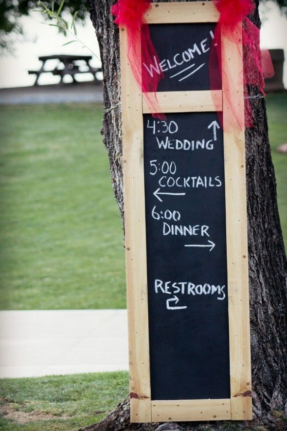 Wooden frame chalkboard directions sign.
