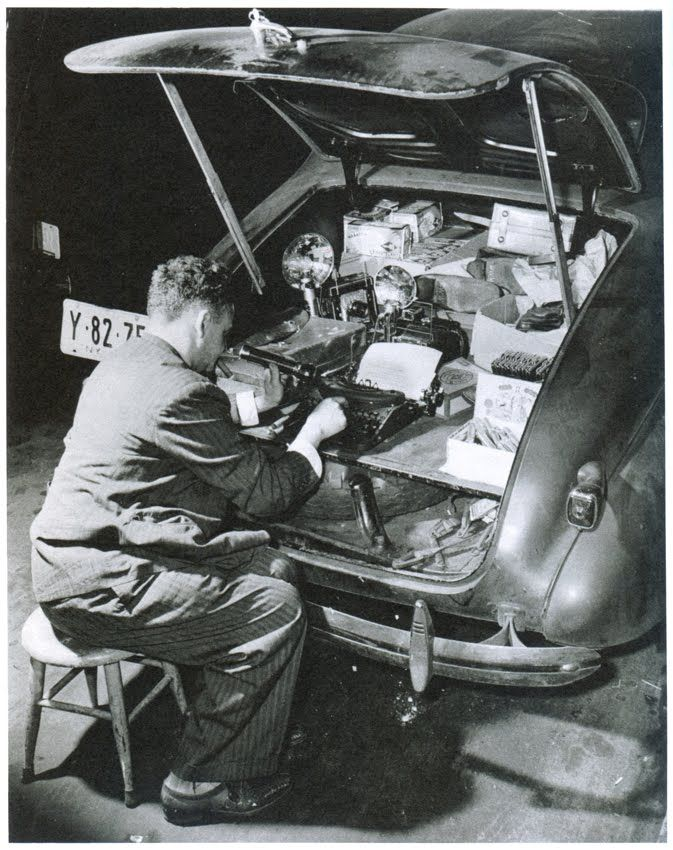 Weegee (Arthur Fellig). I read he would develop prints in his car.