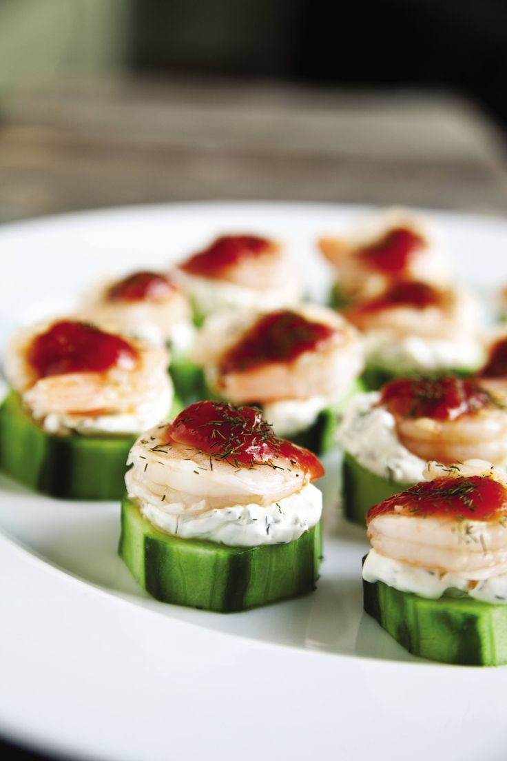 A fresh, modern twist on the classic shrimp cocktail, served on top of thick cucumber slices.