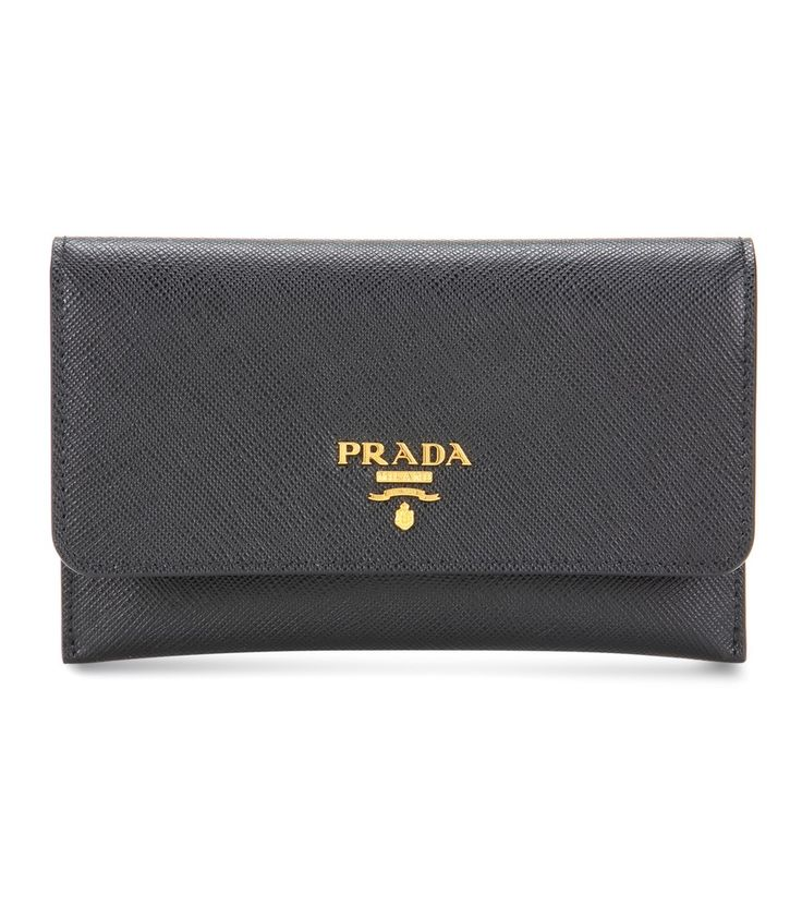 Prada - Leather wallet - Trade out your oversized wallet for Prada's sleek design in classic black. Crafted in Italy from textured saffiano leather and displaying the designer's name in elegant gold tone, this style features a removable card holder and space for cash. seen @ www.mytheresa.com