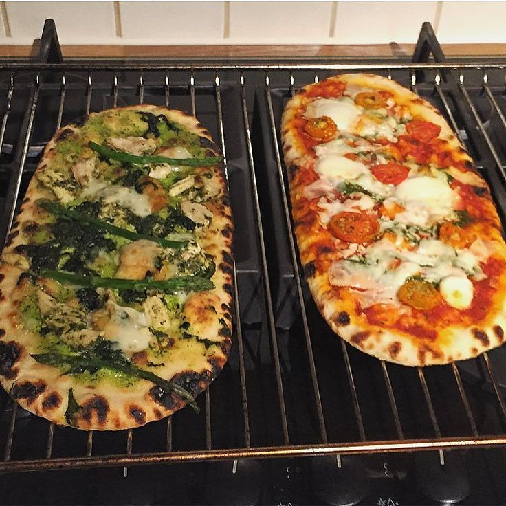 Some more pizza action . . left: wood fired thin Pollo Primavera topped with a creamy pea & mint purée tender marinated chicken with lemon & basil fine asparagus sautéed spinach & Parmigiano Reggiano  was beautiful. .  Calories 414 protein 19.2 fat 15.9 carb 46.8. .  Right: wood fired thin Mozzarella Di Bufala & Rocket Pesto topped with mozzarella di bufala pearls slow roasted red Santarella tomatoes and yellow tomatoes rocket pesto & shavings of mozzarella cheese  was also delicious but not…