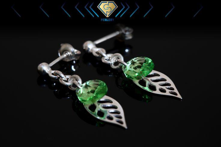 Swarovski silver leaf earrings.