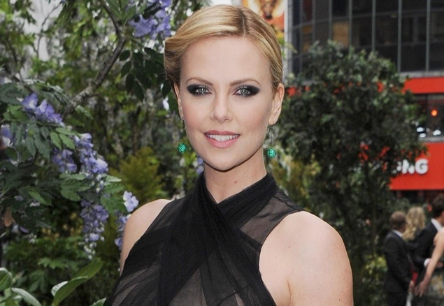 Charlize Theron reveals she didn't have any teeth until age 11: It was 'quite devastating'
