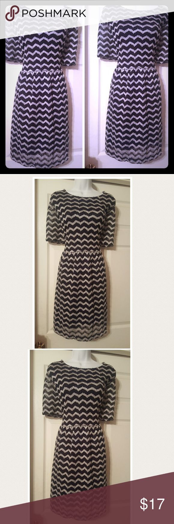 Black and silver chevron print fit and flare dress Cute Black and silver chevron print fit and flare dress with a high round neckline and 3/4 length sleeves. Dress is in excellent like new condition Dresses