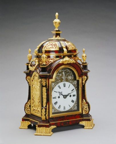 Table clock | Royal Collection Trust.: James Newton (active 1760) (clockmaker)   Creation Date:    c.1765 .     Tortoiseshell-veneered oak case with gilt bronze mounts and enamel and silver dial .  Dimensions:    38.0 x 23.0 x 17.5 cm .      .    Acquirer: George III, King of the United Kingdom (1738-1820), when King of Great Britain (1760-1800).Now belonging to Queen Elizabeth 11.
