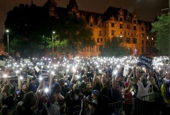 Protesters stand outside of the St. Louis city jail on Monday, Sept. 18, 2017. The protesters chante... - David Carson, St. Louis Post-Dispatch via AP