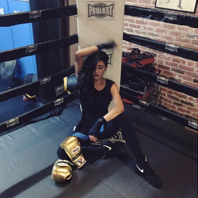 Shay Mitchell in a boxing ring...