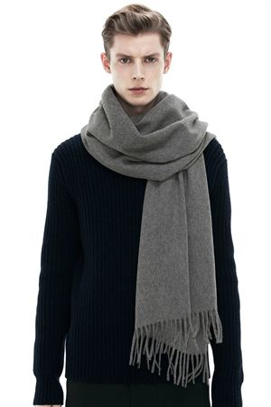 Acne Studios Canada grey melange is an oversized wool scarf with fringed  detailing.