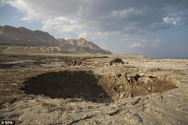 Evidence of the water scarcity shows itself as exposed sinkholes (pictured), cracked mud f...