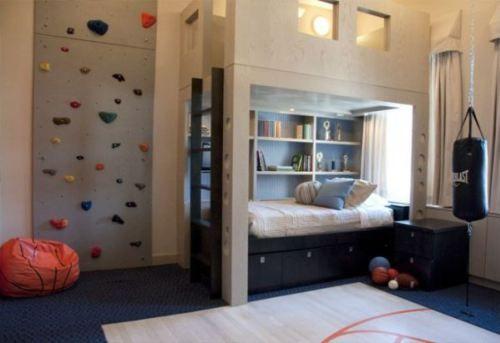 Teenage boy bedroom featuring unique rock climbing wall and loft.