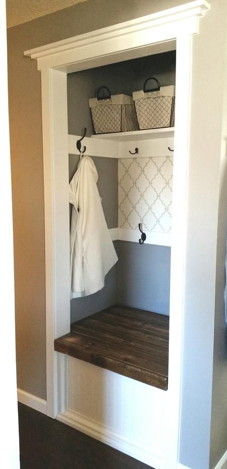 Hallway Closet Makeover DIY with a bench seat that opens for storage! Grey and white, coat hooks.