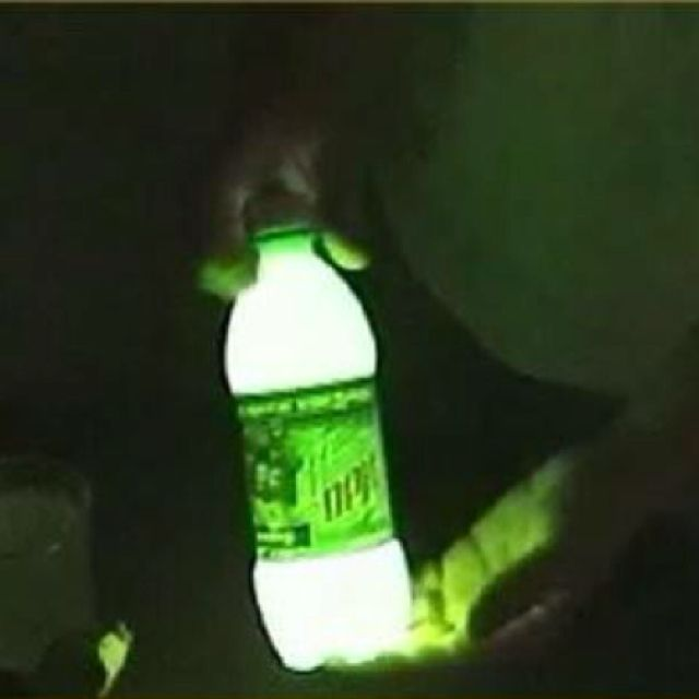 "SO. FREAKING. COOL. 1/4"" Mt Dew in bottle, add tiny bit of baking soda and 3 capfuls of hydrogen peroxide. Shake and it glows. Pour on sidewalk to ""paint""...Who knew!?"