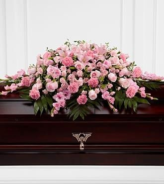 The FTD® Sweetly Rest™ Casket Spray is a wonderful way to commemorate a life abundant in beauty and love. Blushing pink roses, spray roses, carnations, gladiolus, mini carnations and Asiatic lilies ar