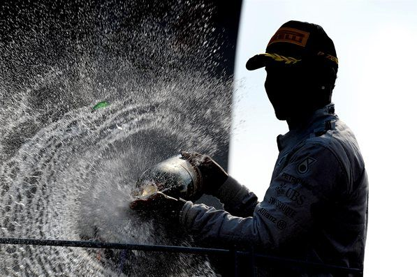 Race winner Lewis Hamilton (GBR) Mercedes AMG F1 celebrates on the podium with the champagne. Formula One World Championship, Rd13, Italian Grand Prix, Monza, Italy, Race Day, Sunday, 7 September 2014