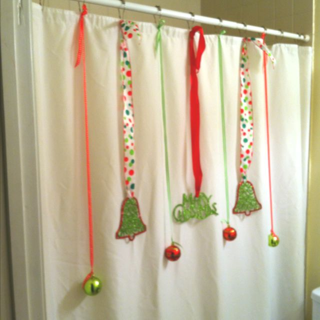 Make a plain white shower curtain festive for Christmas with inexpensive plastic ornaments and ribbon!