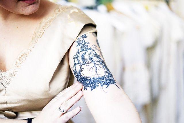 http://tattoomagz.com/blue-tattoos/blue-ink-tattoo-anatomic-heart-2/
