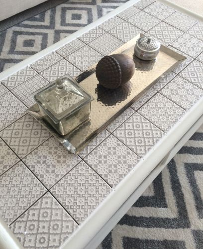 Upcycled coffee table using geometric tiles and chalk paint.