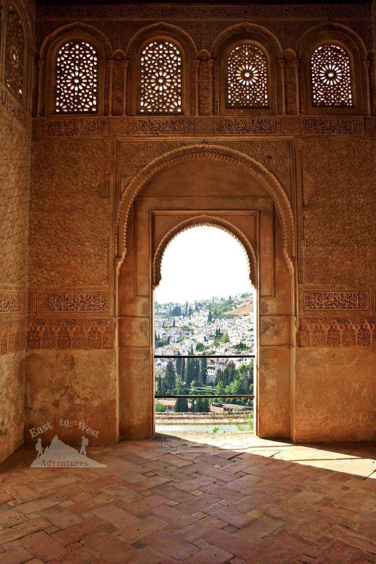 A view of the city from the palace 😍🚪منظر مدينة غرناطة من قصر الحمراء #easttowestadventures #windowview #cityscape #eveninglight #caligraphy #stonework #decorativeart #interiordesign #moors #granada #alhambra #nasridpalace #travelcouple #romanticgetaway #classics #spain #espana #favorites #amazingday #travelblog #arountheworld #perfectday #loveit #instatravel #instahistory #مغامرات_من_الشرق__الى_الغرب #اسبانيا #الاندلس #قصر_الحمراء #غرناطة